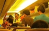 Warga Dunia Maya Bicarakan Foto Jokowi Naik Pesawat Kelas Ekonomi