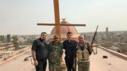 Lepas dari ISIS, Tentara Irak Bawa Kembali Salib Gereja ke Niniwe