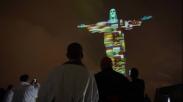 Doakan Wabah Corona, Patung Yesus Memberkati Brasil Dihiasi Bendera Dari Berbagai Negara