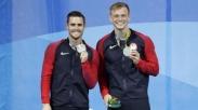 2 Atlit Olimpiade Ini Dedikasikan Medalinya Untuk Kristus